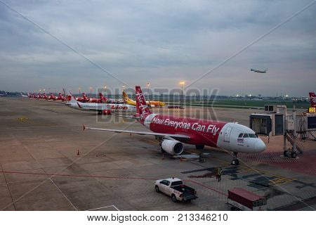 BANGKOK THAILAND - NOV22017 : air asia plane large low cost airline business in south east asia in don muang airport parking area