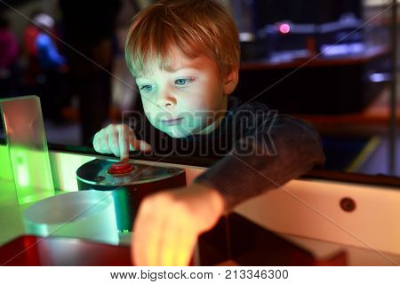 Child Playing With Refraction Of Light
