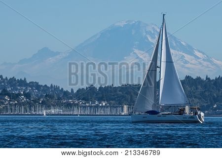 Sailing Vessel One Man Wolfpack transiting Seattle's Shilshole Bay with Mount Rainier in the backgrounds