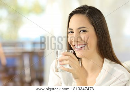 Happy Woman Holding A Glass Of Water