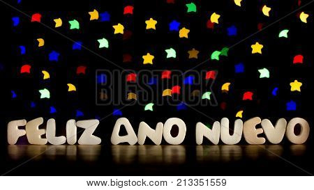 Feliz ano nuevo happy new year in Spanish language text beautiful multicolor bokeh background with copy space