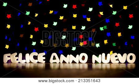 Felice anno nuevo happy new year in Italian language text beautiful multicolor bokeh background with copy space