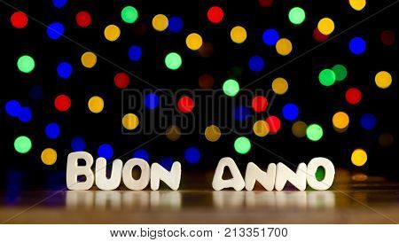 Buon anno happy new year in Italian language text beautiful multicolor bokeh background with copy space