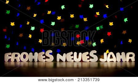 Frohes neues jahr happy new year in German language text beautiful multicolor bokeh background with copy space