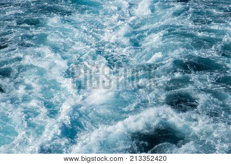Abstract of cruise ship boat wake in the Pacific Ocean waters in New Caledonia.