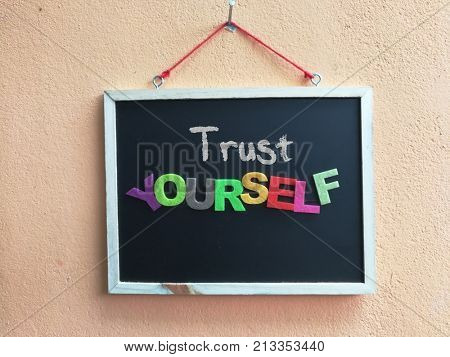 Trust yourself word on blackboard
