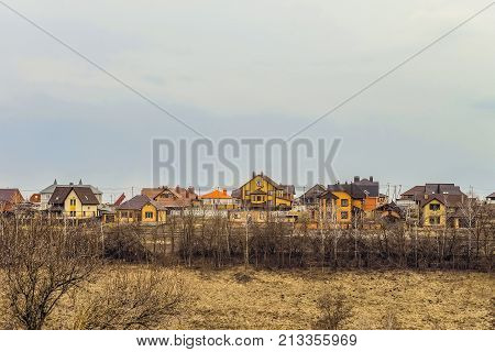 Suburban skyline. Buildings individual suburban housing in early spring. Belgorod Region Russia.