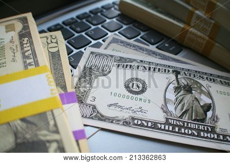 Million Dollar Bill Surrounded With Stacks Of Money High Quality Stock Photo