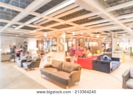 Blurred Huge Furniture Store Retail In America With Customers Shopping