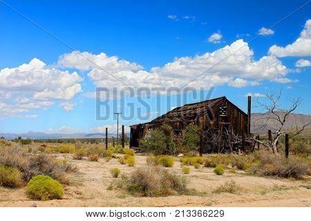 Abandoned cabin in the vast desert