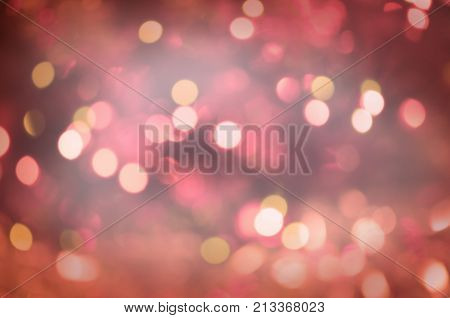 Red Christmas Glitter Lights Background. Defocused Abstract Red Background