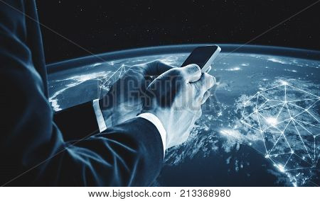 Businessman using mobile smart phone with global network connection. Business network connection and business communication concept. Elements of this image are furnished by NASA