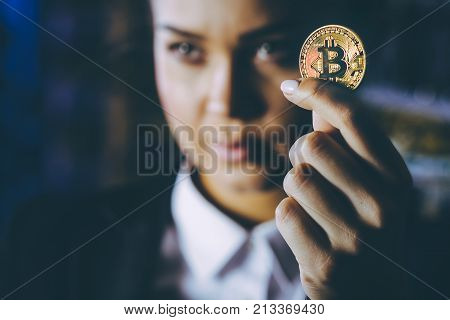 coin bitcoin cryptocurrency hold hand blured female