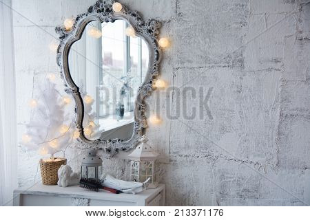 Mirror In An Old Frame And A White Christmas Tree