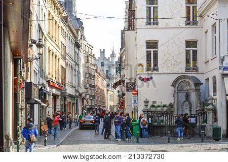 Brussels, Belgium - April 2015: Group Of Tourists Visiting Manneken Pis Or Little Man Pee, A Landmar