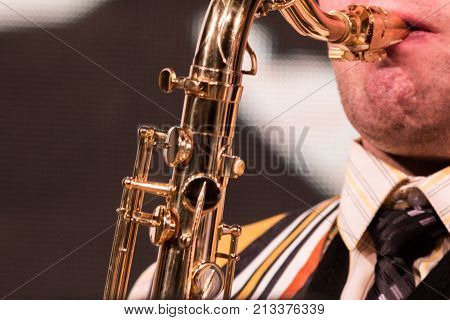 Part of the saxophone in the musician's performances. close up.
