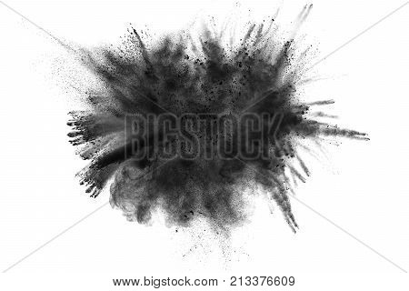 The particles of charcoal splatted on white background.Black powder explosion. Closeup of black dust particles explode isolated on white background.