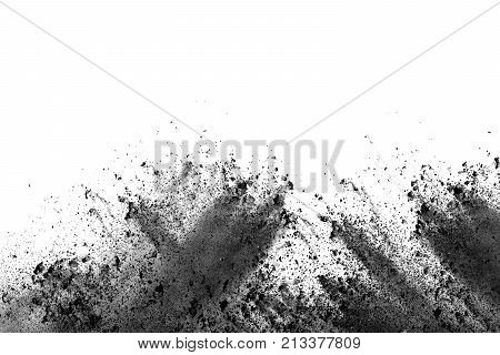 Black powder explosion. The particles of charcoal splatter on white background. Closeup of black dust particles splash isolated on  background.