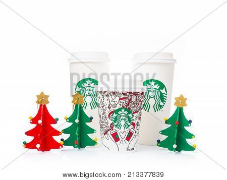 Chiang Mai Thailand- 11 November 2017 - 2 sizes Grande and Venti of Starbucks Coffee paper cups with Grande size cup in beautiful 2017 Christmas design are displayed on white background in Chiang Mai Thailand on November 11 2017