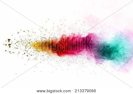 abstract multicolored powder splatted on white background. Freeze motion of yellow red green color powder exploding.