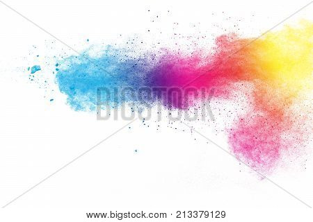 abstract multicolored powder splatted on white background.Freeze motion of blue pink yellow color powder exploding