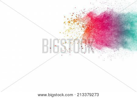Multicolored powder explosion on white background. Red yellow and green color painted on powder splashed.
