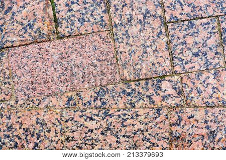 The Stone Pavement. Texture Of Stones On Road Closeup. Part Of A Road Paved With Square Stones Of Re