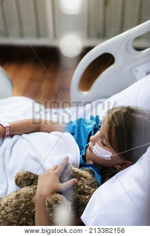Young Caucasian girl staying at a hospital