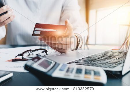 Young Woman Holding Credit Card And Using Smart Phone For Online Shopping. Online Payment Shopping C