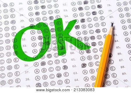 Correctly positive test OK. Blank multiple choice answer sheet filled with pencil