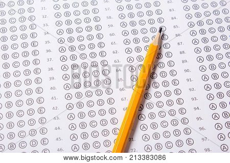 Blank multiple choice answer sheet empty with pencil