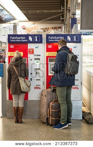 MunichGermany-Nov.082017: Passengers buy their train tickets at a vending machine in Munich's central station