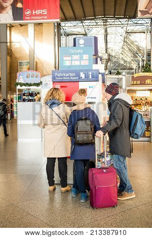 MunichGermany-Nov.082017: A family purchases train tickets at a vending machine in Munich's Central Station