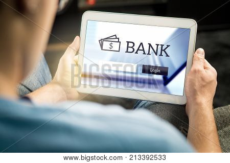 Man Using Mobile Bank Application With Tablet And Smart Device At Home. Login Page To Personal Accou
