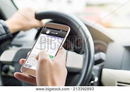 Texting While Driving Car. Irresponsible Man Sending Sms And Using Smartphone.