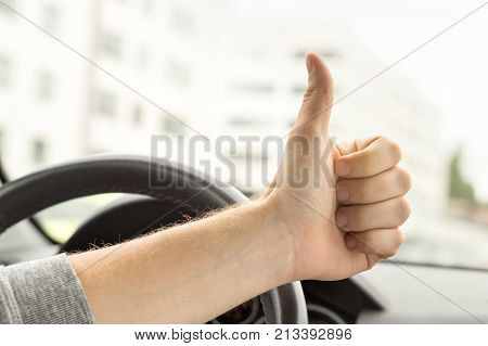 Happy Driver Showing Thumbs Up In Car. Satisfied With New Car Or No Traffic.