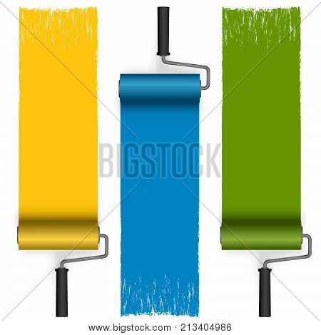 collection of paint rollers with painted markings in different colors