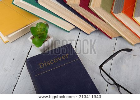 Travel And Education Concept - Top View Of Colorful Hardback Books And Text