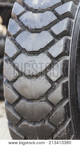 close up photo of new deep-treaded truck tire