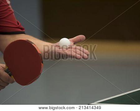 table tennis player serving, closeup