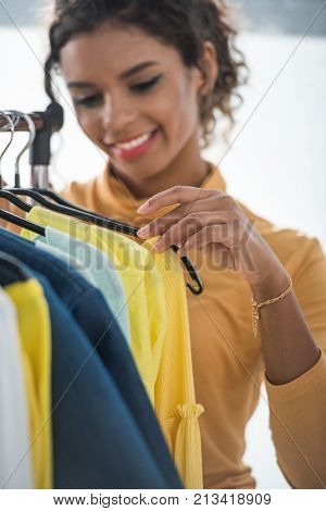 African American Fashion Designer With Clothes