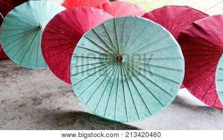 Thai style handmade colorful umbrellas background. The handmade ancient umbrella of Chiang Mai, the north of Thailand, Lanna umbrella.