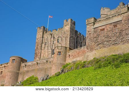 Bamburgh Castle north east England UK in summer with clear blue sky