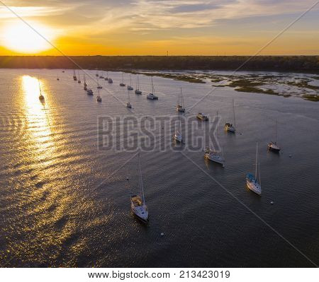 Aerial view of sailboats moored in Beaufort, South Carolina at sunset