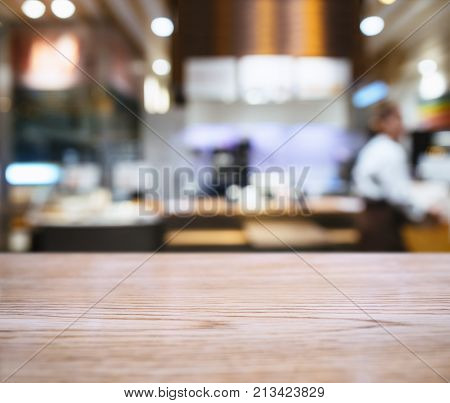 Table Top counter with Blur people Cafe Restaurant Interior