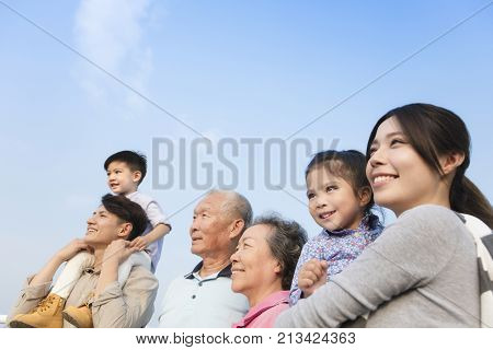 three generations family having fun together outdoors
