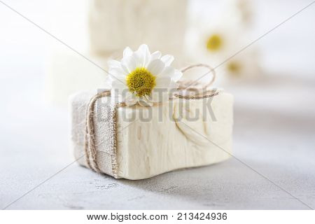 Natural handmade soap with chamomile, the concept of spa and health. Selective focus