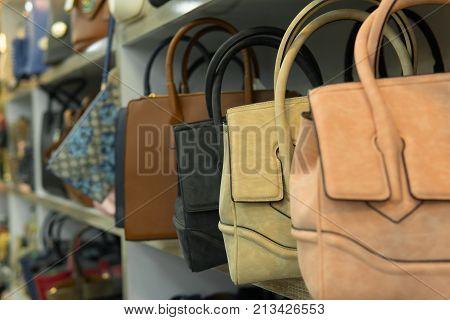 Leather And Chamois Bags On Shelf, Handbag Shop