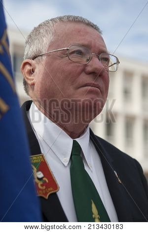 Aubagne, France. May 11, 2012. Portrait of a veteran of the French foreign legion with the banner of veterans of the foreign legion during the annual meeting of veterans.