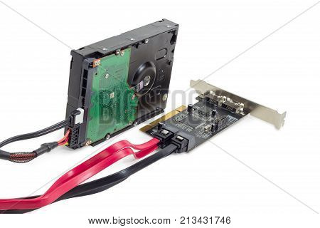 Hard disk drive for use in desktop computers and servers and disk array controller card with connected power cable and data cables on a white background